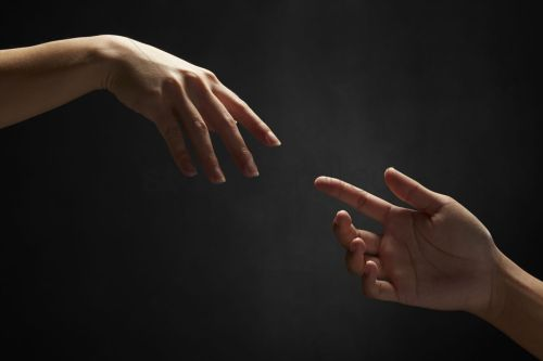 hands-reaching-out-to-one-another_1862775
