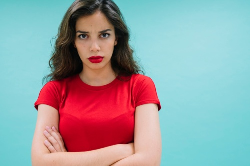 angry-woman-with-crossed-arms_23-2147653644